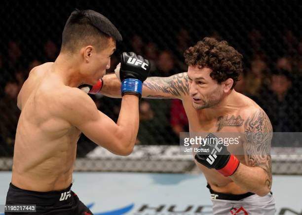 Frankie Edgar punches Chan Sung Jung of South Korea in their featherweight fight during the UFC Fight Night event at Sajik Arena 3 on December 21...