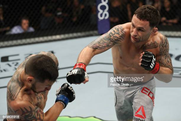 Frankie Edgar punches Cub Swanson in their featherweight fight during the UFC Fight Night event at the Boardwalk Hall on April 21 2018 in Atlantic...