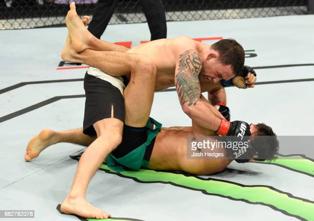 Frankie Edgar punches Yair Rodriguez in their featherweight fight during the UFC 211 event at the American Airlines Center on May 13 2017 in Dallas...