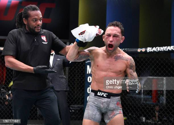 Frankie Edgar reacts after his split-decision victory over Pedro Munhoz of Brazil in their bantamweight fight during the UFC Fight Night event at UFC...