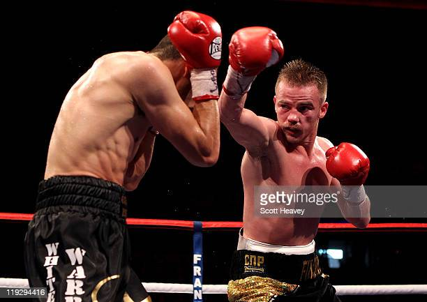 Frankie Gavin attempts a right jab on Curtis Woodhouse during the WBO Intercontinental Welterweight Championship bout bout at Echo Arena on July 16...