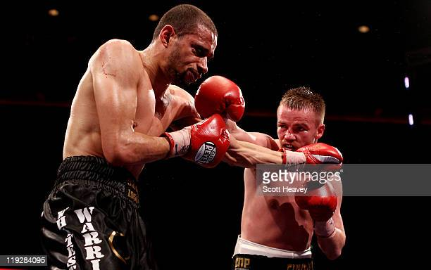 Frankie Gavin connects with Curtis Woodhouse during the WBO Intercontinental Welterweight Championship bout bout at Echo Arena on July 16, 2011 in...