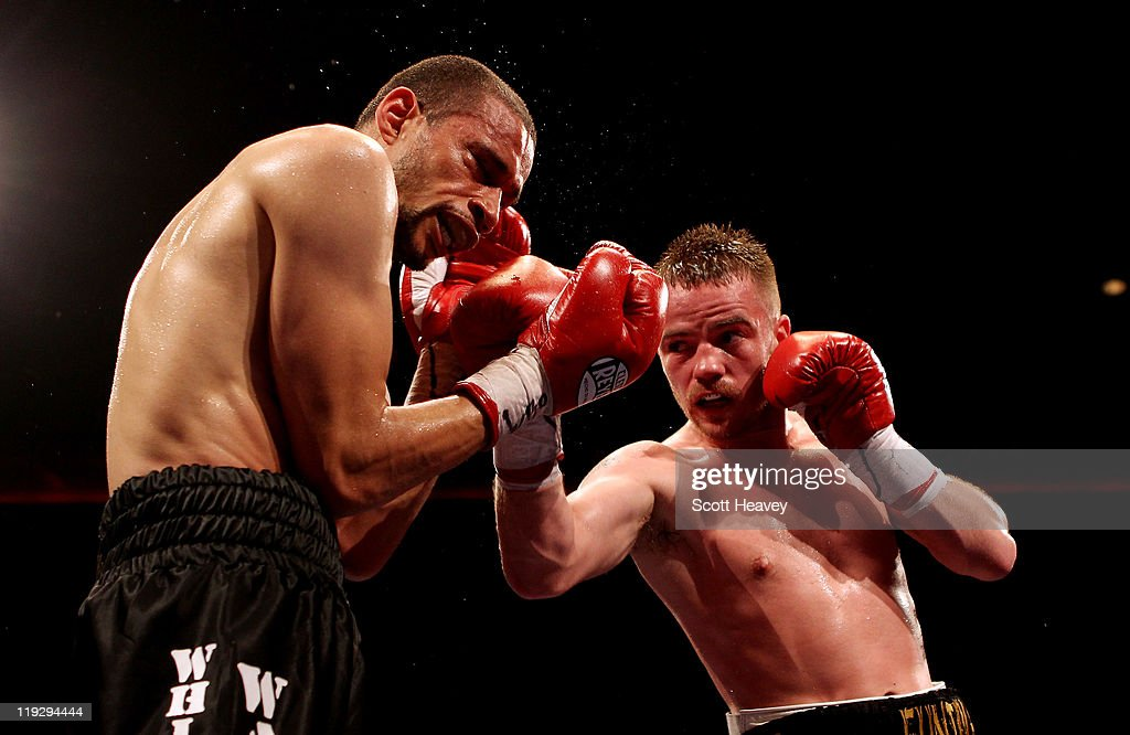 Frankie Gavin (R) connects with Curtis Woodhouse during the WBO Intercontinental Welterweight Championship bout bout at Echo Arena on July 16, 2011 in Liverpool, England.