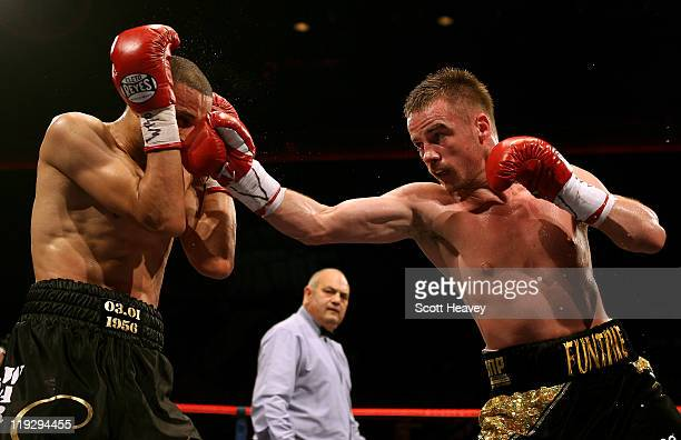Frankie Gavin connects with Curtis Woodhouse during the WBO Intercontinental Welterweight Championship bout bout at Echo Arena on July 16 2011 in...