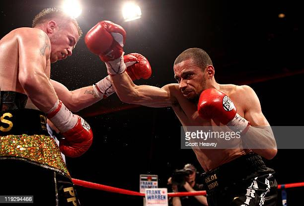 Frankie Gavin is caught by Curtis Woodhouse during the WBO Intercontinental Welterweight Championship bout bout at Echo Arena on July 16 2011 in...