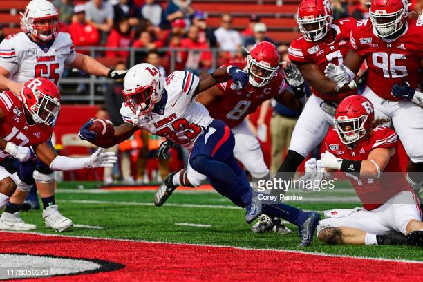 Frankie Hickson of the Liberty Flames scores the first touchdown against the Rutgers Scarlet Knights during the first quarter SHI Stadium on October...
