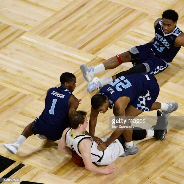 Frankie Johnson guard and Alex Reed forward The Citadel Bulldogs dive onto Storm Murphy guard Wofford College Terriers in a scramble for a loose...