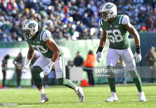Frankie Luvu and Darron Lee of the New York Jets in action against the Buffalo Bills at MetLife Stadium on November 11 2018 in East Rutherford New...