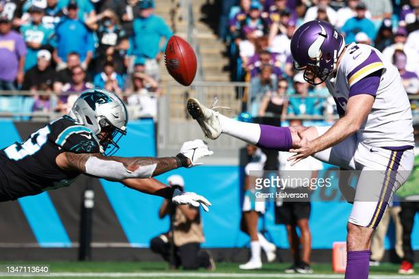 Frankie Luvu of the Carolina Panthers blocks the punt kick return by Jordan Berry of the Minnesota Vikings during the third quarter at Bank of...