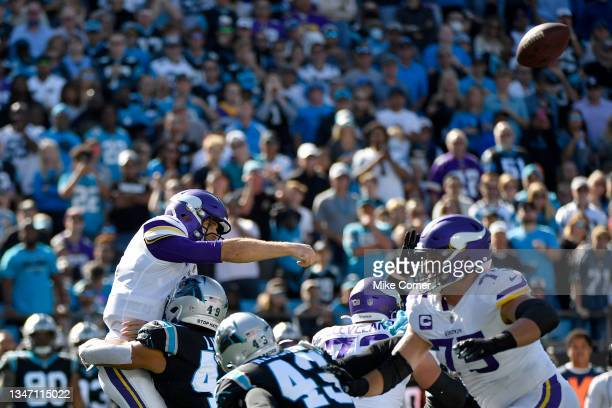 Frankie Luvu of the Carolina Panthers tackles Kirk Cousins of the Minnesota Vikings during the third quarter at Bank of America Stadium on October...
