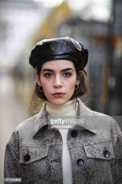 Frankie Miles wearing animal print twinset jacket and skirt reserved snake print Turtleneck S Oliver hat topshop on March 19 2019 in Berlin Germany