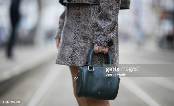 Frankie Miles wearing animal print twinset jacket and skirt reserved snake print bag day et hat topshop on March 19 2019 in Berlin Germany