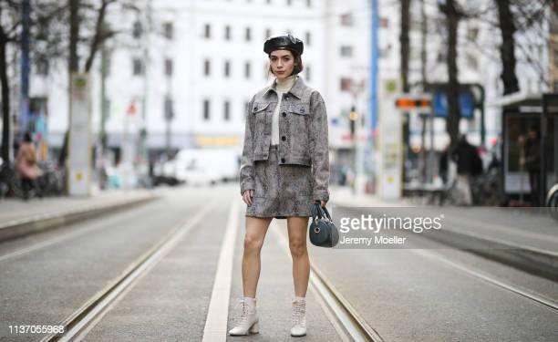 Frankie Miles wearing animal print twinset jacket and skirt reserved snake print Turtleneck S Oliver Boots Mango Bag day et hat topshop on March 19...