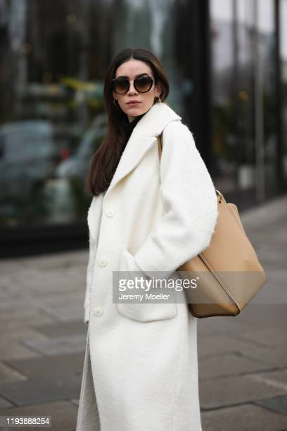 Frankie Miles wearing Bally loafer, Uniqlo x JW Anderson pants, Wolford Body, Weekday coat, Cochinelle bag and Etnia sunglasses on December 12, 2019...