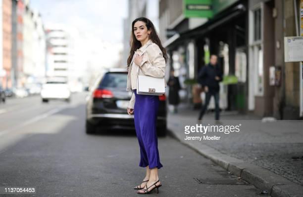 Frankie Miles wearing Beige vinyl jacket by yoox Furla Bag Mimi gold Hair Clip Asos Jewelry hoop earrings Maria Black Slip silk skirt Asos purple...