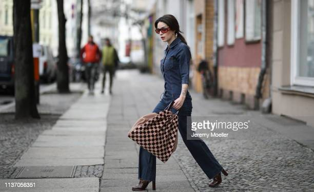 Frankie Miles wearing flared jeansoverall vintage, sunglasses carrera facer, Baum & Pferdgarten bag, Boots croco Topshop, jewelry hoops Maria Black...