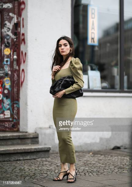 Frankie Miles wearing olive green slip dress baloon sleeves Zara Strappy sandals topshop bottega veneta pouch bag jewelry lauralee on March 19 2019...
