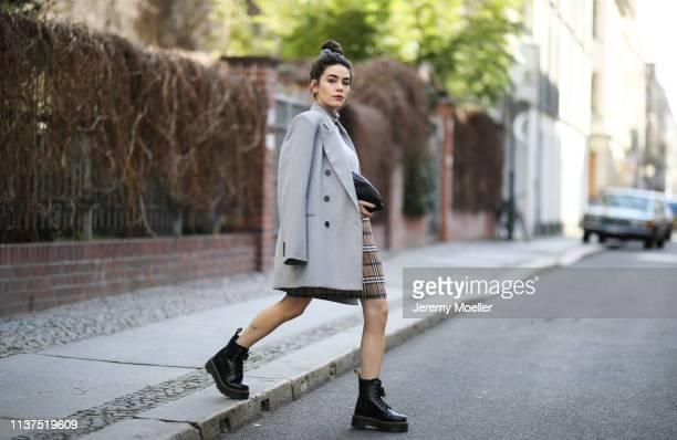 Frankie Miles wearing Oversize grey Blazer Frankie Shop Grey turtleneck Amazon find Checked mini skirt Sandro Bag bottega veneta pouch Boots dr...