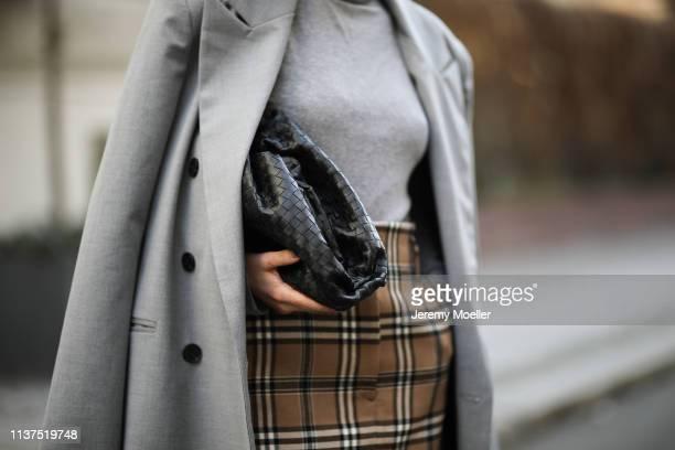Frankie Miles wearing Oversize grey Blazer Frankie Shop Grey turtleneck Amazon find Checked mini skirt Sandro Bag bottega veneta pouch on March 20...