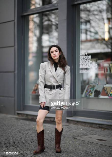 Frankie Miles wearing Shoulder pad Blazer and other Stories Cycling pants topshop Utility Belt Asos Cowboy Boots Vintage on March 19 2019 in Berlin...