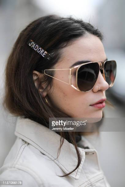 Frankie Miles wearing white Denim jacket wrangler pilote sunglasses givenchy Hair clips Asos on March 19 2019 in Berlin Germany