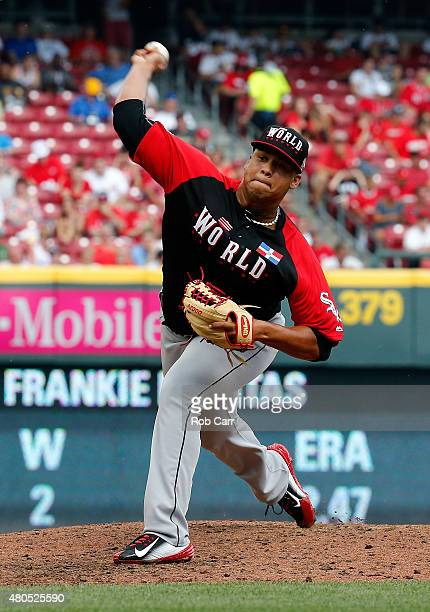 Frankie Montas of the World Team throws a pitch against the US Team during the SiriusXM AllStar Futures Game at the Great American Ball Park on July...