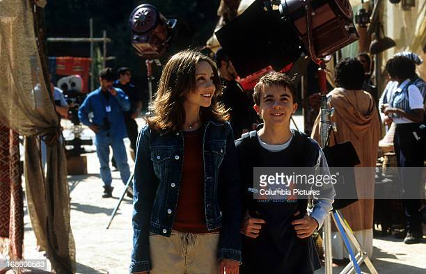 Frankie Muniz and Amanda Bynes walking behind the scenes of a film production in a scene from the film 'Big Fat Liar' 2002