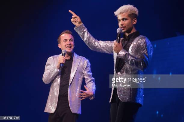 Frankie Muniz and Jordan Fisher perform on stage during Dancing With The Stars Live at WaMu Theater on March 13 2018 in Seattle Washington