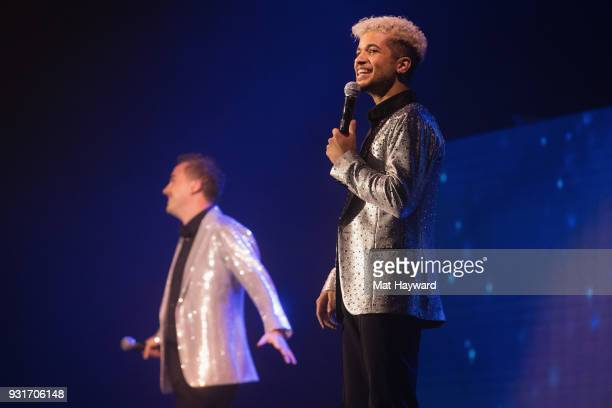 Frankie Muniz and Jordan Fisher performs on stage during Dancing With The Stars Live at WaMu Theater on March 13 2018 in Seattle Washington
