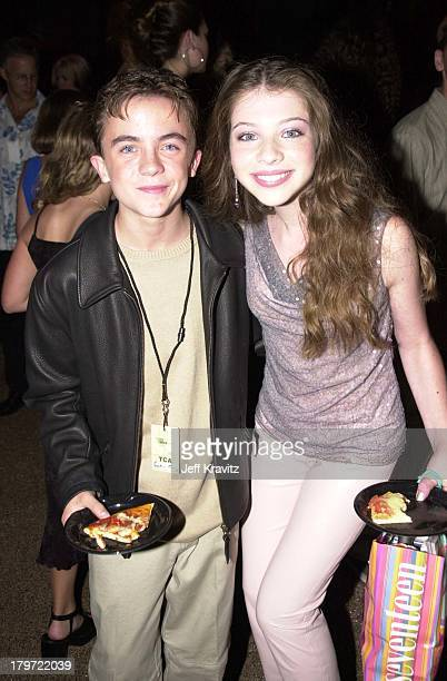 Frankie Muniz and Michelle Trachtenberg during 2000 Teen Choice Awards at Barker Hanger in Santa Monica California United States