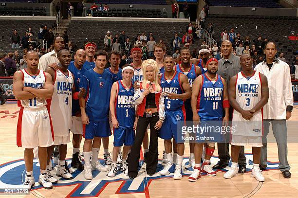 Frankie Muniz Ice Cube Snoop Dogg Tyrese and the rest of the NBAE League team pose on court as the Los Angeles Clippers and Paramount Home...