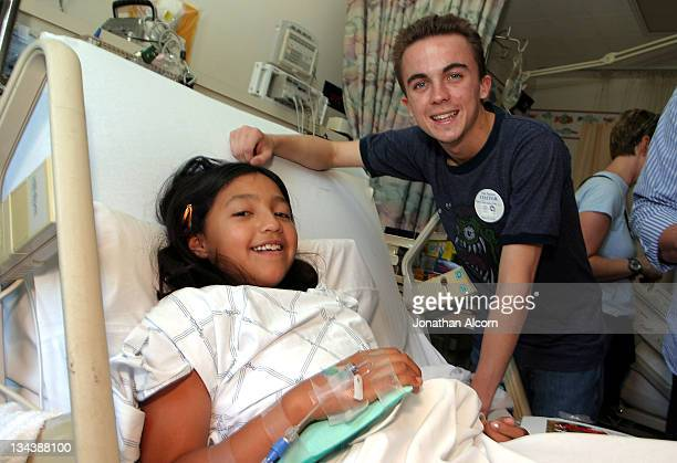 Frankie Muniz meets 10 year old Cynthia Perez during Toyota Grand Prix Pro/Celebs Visit Children's Hospital at Miller's Children Hospital in Long...