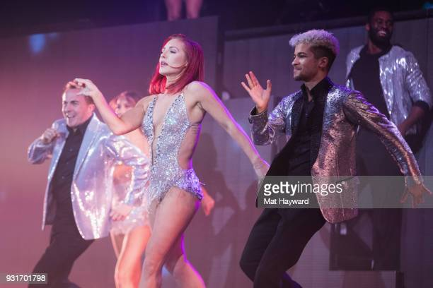 Frankie Muniz Sharna Burgess and Jordan Fisher performs on stage during Dancing With The Stars Live at WaMu Theater on March 13 2018 in Seattle...