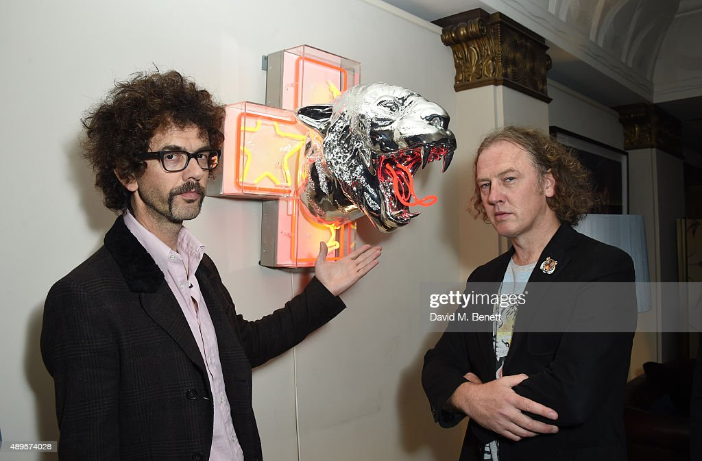 Frankie Poullain and Christian Furr attend The 'BE INSPIRED' art exhibition in aid of Save Wild Tigers, curated by Christian Furr at the Club at Cafe Royal from 22nd September until 8th October 2015 at Cafe Royal on September 22, 2015 in London, England.