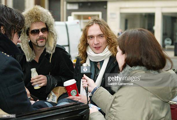 Frankie Poullain and Justin Hawkins of The Darkness leave Radio 1 to promote their new christmas single 'Christmas Time ' on December 19 2003 in...