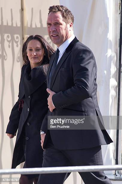 Frankie Poultney and David Seaman sighted departing a service of remembrance for Sir David Frost at Westminster Abbey on March 13 2014 in London...