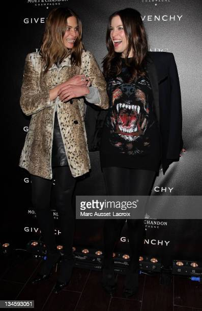 Frankie Rayder and Liv Tyler attend the Givenchy AfterShow Party At l'Arc Paris Fashion Week Fall/Winter 2012 on March 6 2011 in Paris France