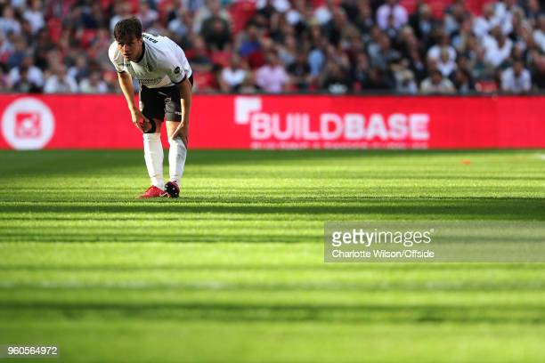 Frankie Raymond of Bromley stretches out his leg in a pool of light during The Buildbase FA Vase Final between Stockton Town and Thatcham Town at...