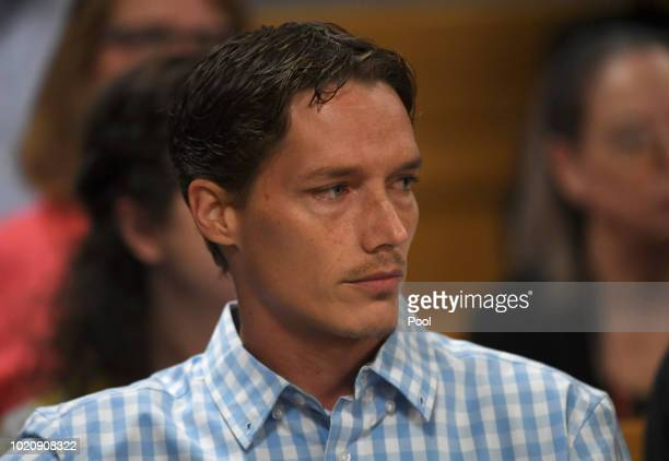 Frankie Rzucek the brother of Shanann Watts looks over at Christopher Watts during an arraignment hearing at the Weld County Courthouse on August 21...