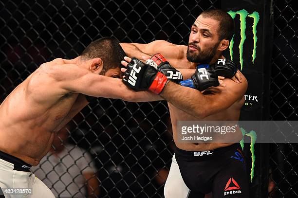 Frankie Saenz lands an elbow to the head of Sirwan Kakai in their bantamweight bout during the UFC Fight Night event at Bridgestone Arena on August 8...