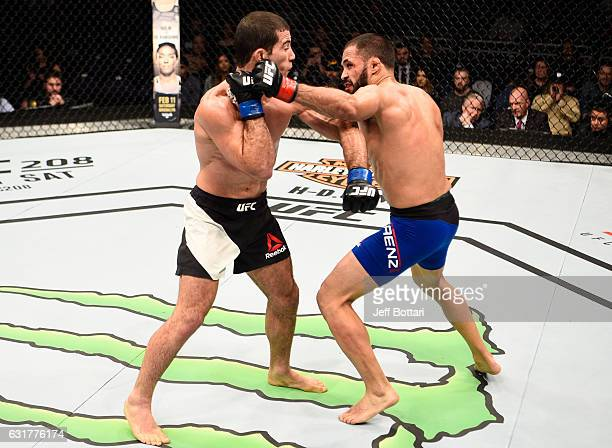Frankie Saenz punches Augusto Mendes of Brazil in their bantamweight bout during the UFC Fight Night event inside Talking Stick Resort Arena on...