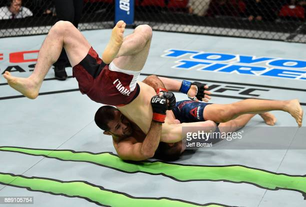 Frankie Saenz takes down Merab Dvalishvili in their bantamweight bout during the UFC Fight Night event inside Save Mart Center on December 9 2017 in...