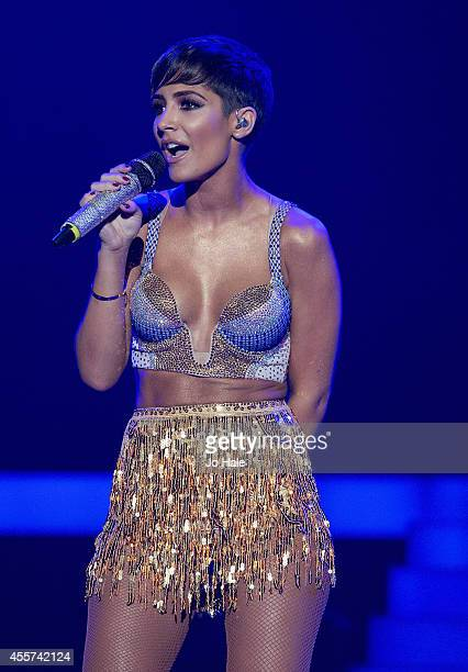 Frankie Sandford of The Saturdays performs on stage at Wembley Arena on September 19 2014 in London United Kingdom
