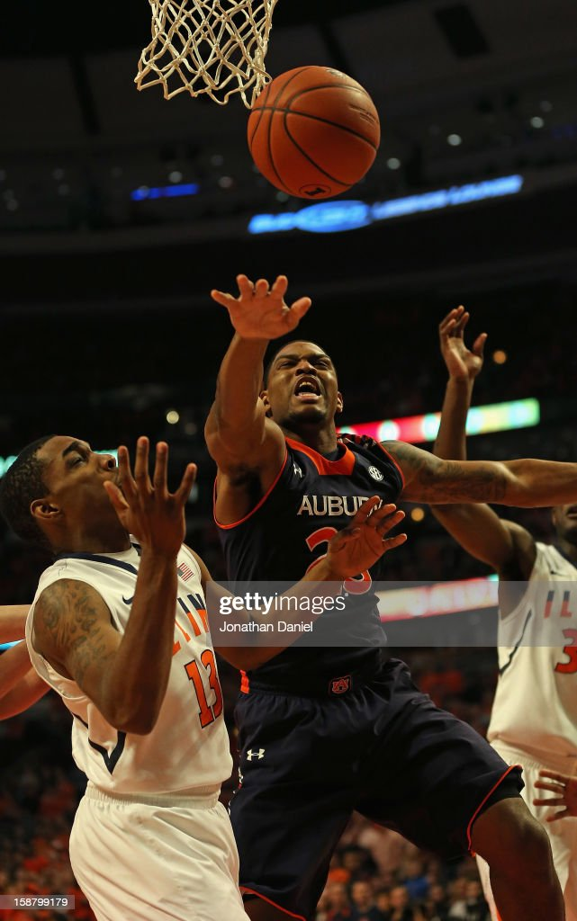 Frankie Sullivan #23 of the Auburn Tigers looses control of the ball under pressure from Tracy Abrams #13 of the Illinois Fighting Illini at United Center on December 29, 2012 in Chicago, Illinois.