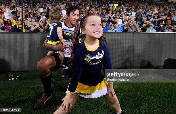 Frankie Thurston poses for the cameras as behind her father Johnathan Thurston and sister Lillie Thurston prepare for a photo after Johnathan...