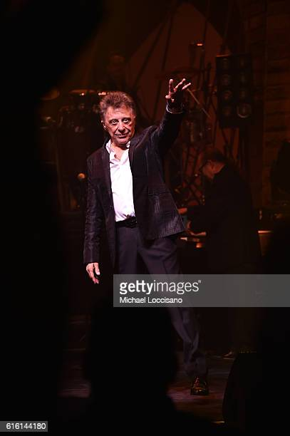 Frankie Valli greets audience during a curtain call during 'Frankie Valli And The Four Seasons' Broadway Opening Night at LuntFontanne Theatre on...