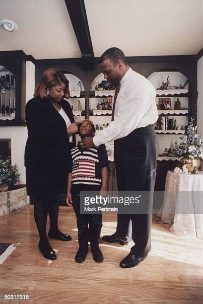 Frankie Watts getting ready for church with youngest son Trey and husband Rep JC Watts at home