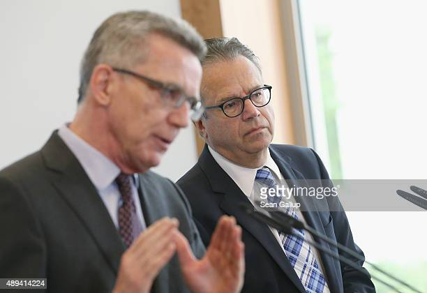 FrankJuergen Weise the newlyappointed head of Germany's Federal Office for Migration and Refugees and German Interior Minister Thomas de Maiziere...