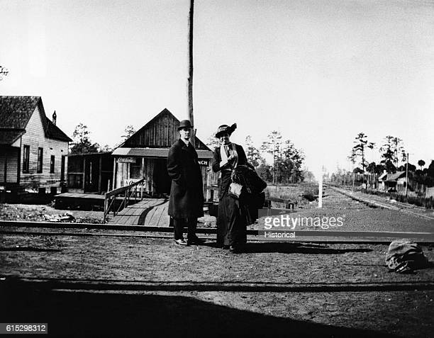 Franklin and Eleanor Roosevelt at a train station in upstate New York during Roosevelt's successful first campaign for the New York State Senate...