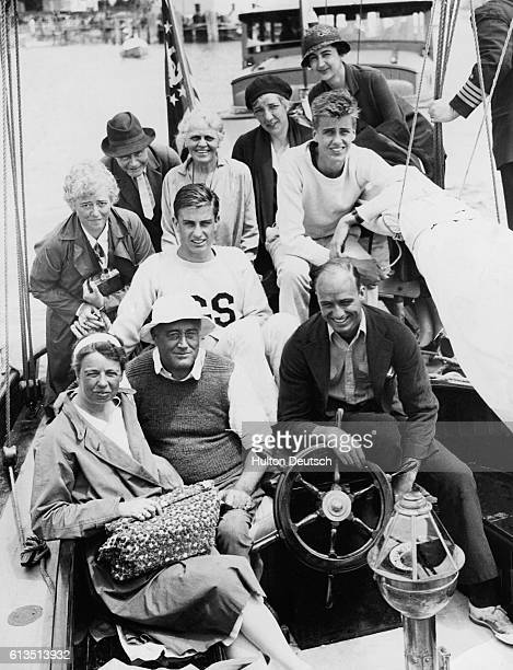 Franklin and Eleanor Roosevelt their three sons and some friends aboard the Amberjack II